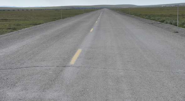Deteriorating pavement, about 45 miles south of Deadhorse