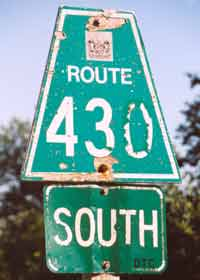 Faded, really old Newfoundland route marker, trapezoid cutout