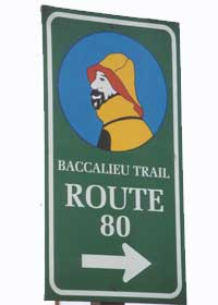 Baccalieu Trail marker, with bearded fisherman in yellow raincoat