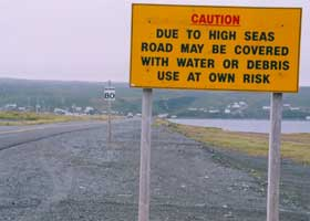 CAUTION | Due to high seas | road may be covered | with water or debris | Use at own risk