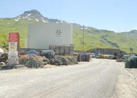 Entrance to Port Lekanoff, at end of Captains Bay Road on west side of Unalaska; private road beyond red No Trspassing sign