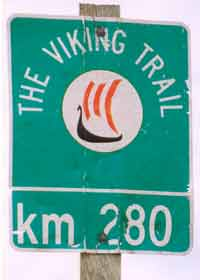 Old Viking Trail marker, faded green with Viking longboat, indicating 280 km distance