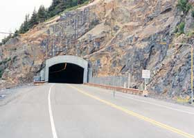 Two-lane highway tunnel under Begich Peak, east portal