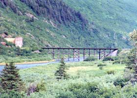 Railroad bridge across Bear Valley, and east portal of railroad tunnel under Begich Peak